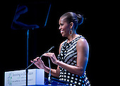 "First lady Michelle Obama makes remarks to open the plenary session ""Investing in our Future"" at the U.S. - Africa Leaders Summit at the John F. Kennedy Center for the Performing Arts in Washington, D.C. on Wednesday, August 6, 2014.<br /> Credit: Ron Sachs / Pool via CNP"