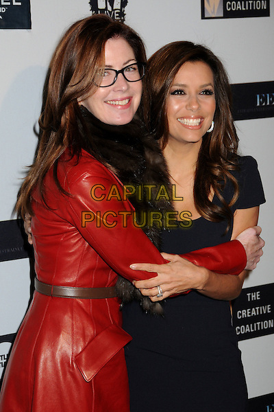 DANA DELANY & EVA LONGORIA PARKER .The Creative Coalition's Spotlight Initiative Dinner held at the Luxe Hotel, Westwood, California, USA..December 8th, 2009.half length jacket dress hand in pocket delaney red leather black fur scarf glasses hug embrace .CAP/ADM/BP.©Byron Purvis/AdMedia/Capital Pictures.