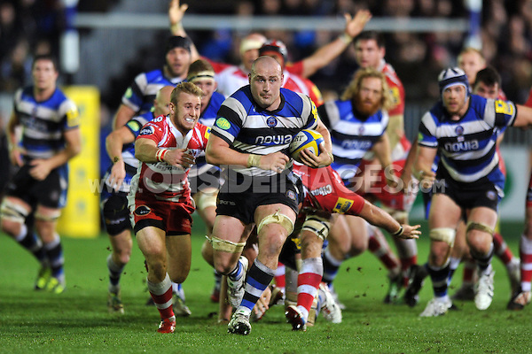 Carl Fearns pounces on loose ball and breaks clear of a scrum. Aviva Premiership match, between Bath Rugby and Gloucester Rugby on October 25, 2013 at the Recreation Ground in Bath, England. Photo by: Patrick Khachfe / Onside Images