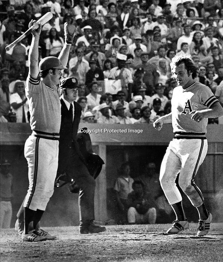 A's Gene Tenace gives the stand-up sign to Rich McKinney who scores.(photo by Ron Riesterer)