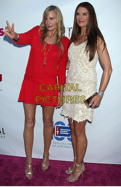 Daryl Hannah, Brooke Shields<br /> &quot;The Hot Flashes&quot; Los Angeles Premiere held at Arclight Cinemas, Hollywood, California, USA, 27th June 2013.<br /> full length red dress white cream lace dress hand v sign peace gesture  <br /> CAP/ADM/RE<br /> &copy;Russ Elliot/AdMedia/Capital Pictures