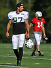 Eric Decker #87, New York Jets wide receiver, paces the field with starting quarterback #14 Ryan Fitzpatrick in background during team training camp at Atlantic Health Jets Training Center in Florham Park, NJ on Saturday, Aug. 6, 2016