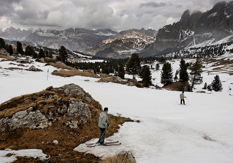 A skier walks over exposed rocksi area in the Alps just outside Ortisei, Italy, in the Val Gardena area of the Dolomites. Usually this area has a lot more snow but temperatures in the Alps are warming.  There are 1200 planes that fly over this pass every day.  According to helicopter pilots recording data, it's not the heat of their engines, but the jet trails they leave, affect the sun hitting the landscape and warm the area by at least 1 degree celsius.<br /> <br /> A ski area in the Alps just outside Ortisei, Italy, in the Val Gardena area of the Dolomites.  Specifically Passo Di Sella Ski area.