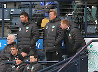 Neil Lennon (right) consults with Gary Parker (left) and Johan Mjallby in the St Mirren v Celtic Scottish Communities League Cup Semi Final match played at Hampden Park, Glasgow on 27.1.13.