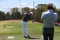 Oliver Wilson (ENG) gets the watching eye of Robert Rock (ENG) on the range during the preview of the Tshwane Open 2015 at the Pretoria Country Club, Waterkloof, Pretoria, South Africa. Picture:  David Lloyd / www.golffile.ie. 10/03/2015