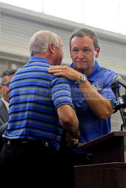 Kentucky athletics director Mitch Barnhart hugs Wendell Bell during the dedication ceremony of the Wendell and Vickie Bell Soccer Complex in Lexington, Ky., on Sunday, August 31, 2014. Photo by Jonathan Krueger | Staff
