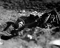 German machine-gun nest and dead gunner.  Villers Devy Dun Sassey, France.  November 4, 1918. Lt. M. S. Lentz. (Army)<br /> NARA FILE #:  111-SC-33408<br /> WAR & CONFLICT BOOK #:  692