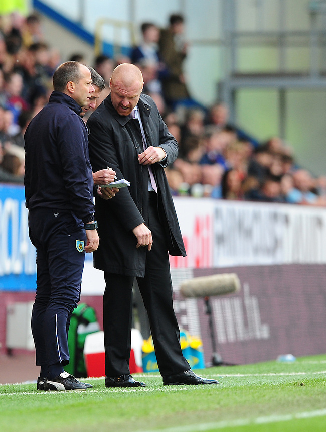 Burnley manager Sean Dyche, right, chats with Burnley's Assistant manager Ian Woan, left, and Burnley's First-team coach Tony Loughlan during the second half<br /> <br /> Photographer Chris Vaughan/CameraSport<br /> <br /> Football - Barclays Premiership - Burnley v Stoke City - Saturday 16th May 2015 - Turf Moor - Burnley<br /> <br /> &copy; CameraSport - 43 Linden Ave. Countesthorpe. Leicester. England. LE8 5PG - Tel: +44 (0) 116 277 4147 - admin@camerasport.com - www.camerasport.com