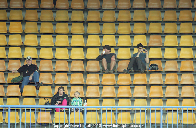 Fans watch from the RA Vance Stand during the HRV Cup Twenty20 cricket match between the Wellington Firebirds and Northern Knights at Hawkins Finance Basin Reserve, Wellington, New Zealand on Sunday, 13 January 2013. Photo: Dave Lintott / lintottphoto.co.nz