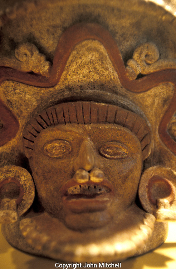 Face on ceremonial stone censer in the museum at the Mayan ruins of El Tazumal, El Salvador, Central America