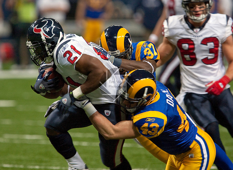 122009tvtackle.Texans RB Ryan Moats (21) is brought down by Rams players James Butler (37) and Craig Dahl (43) in the first half..BND/TIM VIZER