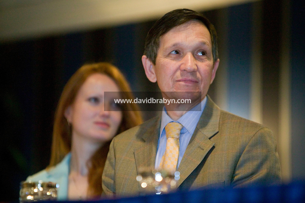 21 April 2007 - New York City, NY - Democratic presidential hopeful congressman Dennis Kucinich (R) waits with his wife Elizabeth looking on before delivering a speech to the 9th Annual National Action Network Convention in New York City, USA, April 2007.
