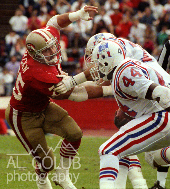 San Francisco 49ers vs New England Patriots at Stanford Stadium Sunday, October 22, 1989..49ers Beat Patriots 37-20.49ers  defensive end Kevin Fagan (75) attempts to tackle Patriots running back John Stephens (44)