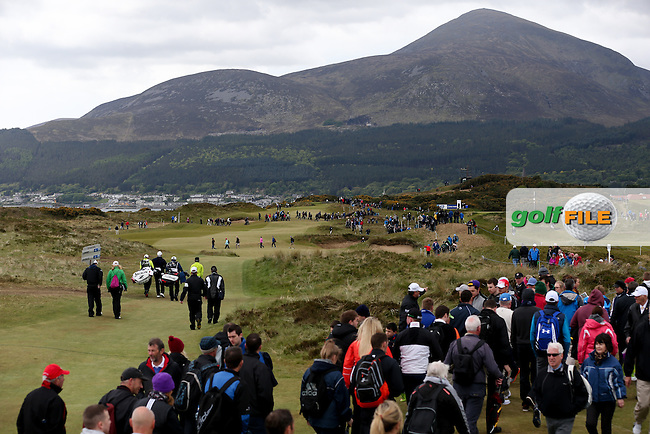 Some five shots behind the leaders, Shane Lowry (IRL) and Thongchai Jaidee (THA) head to the 8th during Round Three of the 2015 Dubai Duty Free Irish Open Hosted by The Rory Foundation at Royal County Down Golf Club, Newcastle County Down, Northern Ireland. 30/05/2015. Picture David Lloyd | www.golffile.ie