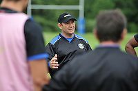 First team coach Darren Edwards speaks to his players. Bath Rugby pre-season training session on July 8, 2014 at Farleigh House in Bath, England. Photo by: Patrick Khachfe/Onside Images