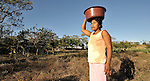 A woman carries grain on her head in La Pacaira, a small village in northwestern Nicaragua.