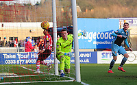 Lincoln City's Bruno Andrade scores the opening goal, heading the ball past Stevenage's Paul Farman<br /> <br /> Photographer Chris Vaughan/CameraSport<br /> <br /> The EFL Sky Bet League Two - Lincoln City v Stevenage - Saturday 16th February 2019 - Sincil Bank - Lincoln<br /> <br /> World Copyright © 2019 CameraSport. All rights reserved. 43 Linden Ave. Countesthorpe. Leicester. England. LE8 5PG - Tel: +44 (0) 116 277 4147 - admin@camerasport.com - www.camerasport.com