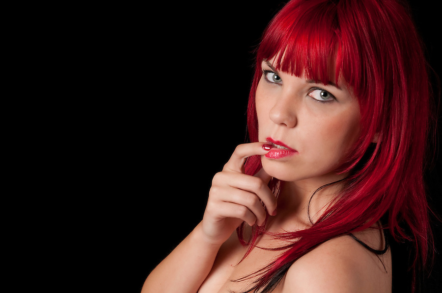 Portrait of very sensual red hair woman with suggestive pose.
