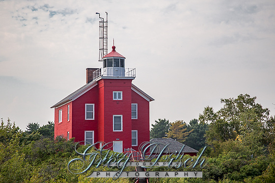 The Marquette Harbor Light is located on Lake Superior in Marquette, Michigan, a part of the Upper Peninsula. It is an active aid to navigation.<br /> <br /> The present lighthouse was constructed in 1866 and a second story added in 1909. The lighthouse is the oldest significant structure in the city and more importantly, the lighthouse is one of the most historic navigation beacons on Lake Superior and critical to the development of the Great Lakes iron ore trade. Until the opening of the major Minnesota mines in the 1890s, Marquette was the premier shipping port for iron ore on the Great Lakes and this Marquette beacon was vital for the safe navigation of ships entering Marquette. This light still shines through for today&rsquo;s sailors.<br /> <br /> Place listed on the National Register of Historic Places July 19, 1984.