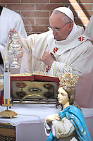 Pope Francis during his pastoral visit to the parish of Saints Elizabeth and Zachary in Prime Door, a suburb of Rome, for the first time and will offering first communion to 16 local children, on May 26, 2013.