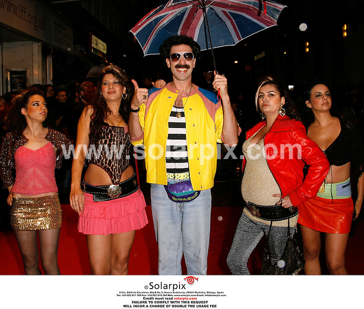 "ALL ROUND EXCLUSIVE PICTURES FROM SOLARPIX.COM.Sacha Baron Cohen in character for the premiere of Borat at the Odeon, Leicester Square in the West End of London.. JOB REF: 2977/PRS..""MUST CREDIT SOLARPIX.COM OR DOUBLE FEE WILL BE CHARGED"".."