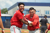 GCL Phillies East Jose Tortolero (right) celebrates with Marcus Lee Sang (left) after hitting a walk-off sacrifice fly during a Gulf Coast League game against the GCL Yankees East on July 31, 2019 at Yankees Minor League Complex in Tampa, Florida.  GCL Phillies East defeated the GCL Yankees East 4-3 in the second game of a doubleheader.  (Mike Janes/Four Seam Images)