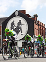 Team Cannondale (ITA) cycle past pro-British Loyalist murals of east Belfast during practice session before the 2014 Giro d'Italia cycling race in Belfast, Northern Ireland, 09 May 2014. Belfast is hosting the Giro d'Italia Big Start (Grande Partenza) with three days of cycling action from 9 to 11 May 2014.