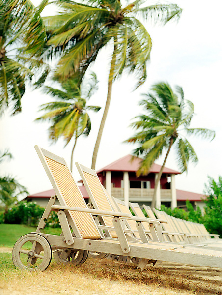 Beach chairs at the Cap Est Lagoon Resort & Spa. Cap Est, Martinique. Eastern Caribbean.