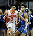 SIOUX FALLS, SD - MARCH 8:  Shane Maple #5 of Governers State drives into Tyson Smiley #11 of Dakota Wesleyan at the 2018 NAIA DII Men's Basketball Championship at the Sanford Pentagon in Sioux Falls. (Photo by Dick Carlson/Inertia)