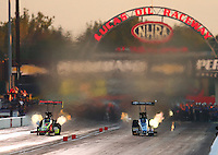 Sep 3, 2016; Clermont, IN, USA; NHRA top fuel driver J.R. Todd (left) races alongside Morgan Lucas during qualifying for the US Nationals at Lucas Oil Raceway. Mandatory Credit: Mark J. Rebilas-USA TODAY Sports
