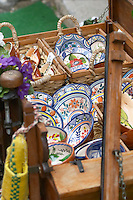 Portuguese craft and earthenware items outside a shop. Lisbon, Portugal