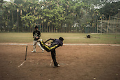 A young bowler throws a ball during the practice session at Maidan in Kolkata, West Bengal, India.