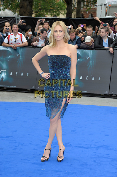 Charlize Theron.'Prometheus' world film premiere, Empire cinema, Leicester Square, London, England..31st May 2012.full length blue strapless shimmery dress sparkly sheer slit split hand on hip.CAP/PL.©Phil Loftus/Capital Pictures.