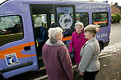 "Three elderly women with a CallConnect bus in the village of Ewerby, Lincolnshire.   The innovative bus-on-demand service features in the Rural Media Company's ""Over the Hill?"" project."