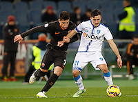 Calcio, Tim Cup: Roma vs Empoli. Ottavi di finale a gara unica. Roma, stadio Olimpico, 20 gennaio 2015.<br /> Empoli's Mario Rui is challenged by Roma's Juan Iturbe, left, during the Italian Cup round of 16 football match between Roma and Empoli at Rome's Olympic stadium, 20 January 2015.<br /> UPDATE IMAGES PRESS/Riccardo De Luca