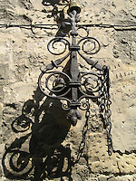 Medieval wrought iron on old wall