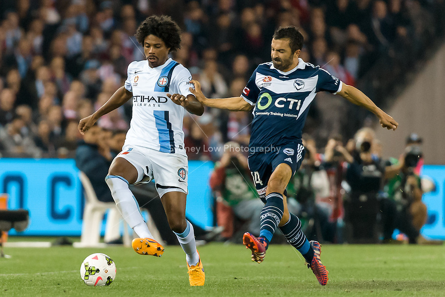 Kew Jaliens of City protects the ball from Fahid Ben Khalfallah of the Victory in the semi final match between Melbourne Victory and Melbourne City in the Australian Hyundai A-League 2015 season at Etihad Stadium, Melbourne, Australia.<br />