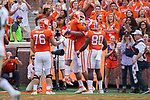 Deon Cain (8) of the Clemson Tigers is congratulated by his teammates after catching a touchdown pass during first half action against the Wake Forest Demon Deacons at Memorial Stadium on October 7, 2017 in Clemson, South Carolina.  The Tigers defeated the Demon Deacons 28-14. (Brian Westerholt/Sports On Film)