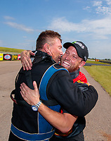 Jun 9, 2019; Topeka, KS, USA; NHRA pro mod driver Steve Jackson (right) is congratulated by Clint Satterfield after winning the Heartland Nationals at Heartland Motorsports Park. Mandatory Credit: Mark J. Rebilas-USA TODAY Sports