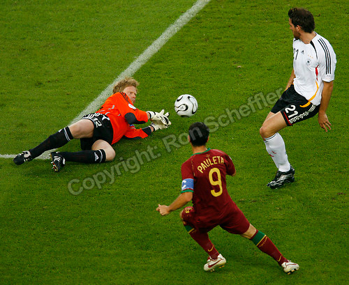 Jul 8, 2006; Stuttgart, GERMANY; Germany goalkeeper (12) Oliver Kahn stops a shot on goal by Portugal forward (9) Pauleta as Germany defender (21) Christoph Metzelder looks on during first half play in the runner-up match to decide third place in the 2006 FIFA World Cup at Gottlieb-Daimler-Stadion, Stuttgart. Mandatory Credit: Ron Scheffler-US PRESSWIRE Copyright © Ron Scheffler.