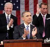 United States President Barack Obama is applauded by Vice President Joe Biden and House Speaker John Boehner of Ohio, pror to delivering his State of the Union address on Capitol Hill in Washington, Tuesday, January 25, 2011.  .Credit: Pablo Martinez Monsivais / Pool via CNP
