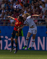 REIMS,  - JUNE 24: Patri Guijarro #12 goes up for a header with Sam Mewis #3 during a game between NT v Spain and  at Stade Auguste Delaune on June 24, 2019 in Reims, France.