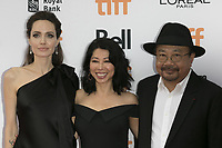 www.acepixs.com<br /> <br /> September 11 2017, Toronto<br /> <br /> (L-R) Angelina Jolie, Loung Ung and Rithy Panh arriving at the premiere of 'First They Killed My Father' during the 42nd Toronto International Film Festival at the Princess of Wales Theatre on September 11 2017 in Toronto, Canada<br /> <br /> <br /> By Line: Famous/ACE Pictures<br /> <br /> <br /> ACE Pictures Inc<br /> Tel: 6467670430<br /> Email: info@acepixs.com<br /> www.acepixs.com