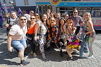 Pictured: Organisers Mark Jermin (L) and Nia Jermin Rae (front row 6th from L) with Eastenders actress  Charlie Brooks (C). Saturday 04 May 2019<br /> Re: Swansea Pride Parade in south Wales, UK.