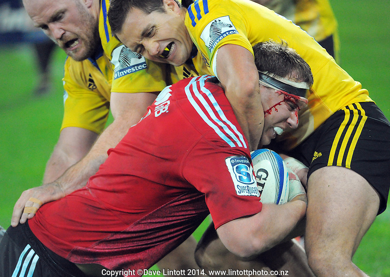 Ben Franks and Tim Bateman combine to stop Wyatt Crockett during the Super Rugby match between the Hurricanes and Crusaders at Westpac Stadium, Wellington, New Zealand on Saturday, 28 June 2014. Photo: Dave Lintott / lintottphoto.co.nz