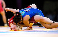 11 DEC 2011 - LONDON, GBR - Sarah Connolly (GBR) (in red) tries to prevent being pinned by Choe Jin-Suk (KOR) (in blue) during thei 63kg category bout during the London International Wrestling Invitational and 2012 Olympic Games test event at the ExCel Exhibition Centre in London, Great Britain .(PHOTO (C) NIGEL FARROW)