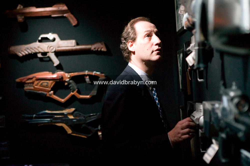 2 October 2006 - New York City, NY - Dr Alan Manevitz examines weapons on display at the preview of items from the TV show Star Trek at Christie's auction house in New York City, USA, 2 October 2006. The auction, on October 5-7, is a celebration of the show's 40th anniversary. Dr Manevitz is a psychiatrist.