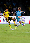 SHENZHEN - JULY 28: Borussia Dortmund midfielder Shinji Kagawa (l) tries to defend Manchester City midfielder Aleix Garcia (r) during an attack of City against Borussia Dortmund at the 2016 International Champions Cup China match at the Shenzhen Stadium on 28 July 2016 in Shenzhen, China. (Photo by Power Sport Images/Getty Images)