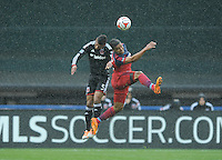 Washington D.C. - March 29, 2014: Quincy Amarikwa of the Chicago FIre heads the ball against Sean Franklin (5) of D.C. United.  The Chicago Fire tied D.C. United 2-2 during a Major League Soccer match for the 2014 season at RFK Stadium.
