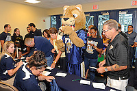 12 August 2011:  FIU's mascot, Roary, joins fans in signing up for a raffle during the FIU 2011 Panther Preview at University Park Stadium in Miami, Florida.